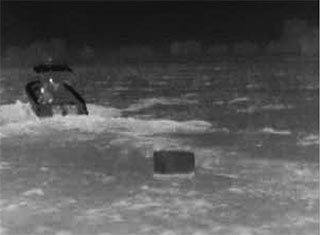 FLIR thermal image of a boat dropping contraband
